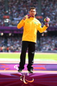 Gold medalist Alan Fonteles Cardoso Oliveira poses on the podium during the medal ceremony for the Men's 200m T44 on day 5 of the London 2012...