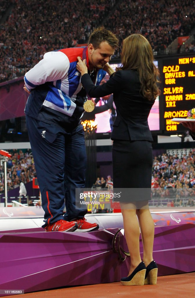 Gold medalist Aled Davies of Great Britain is presented his medal by <a gi-track='captionPersonalityLinkClicked' href=/galleries/search?phrase=Catherine+-+Duchess+of+Cambridge&family=editorial&specificpeople=542588 ng-click='$event.stopPropagation()'>Catherine</a>, Duchess of Cambridge during the medal ceremony for the Men's Discus Throw - F42 on day 4 of the London 2012 Paralympic Games at Olympic Stadium on September 2, 2012 in London, England.