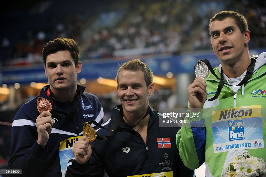 Gold medalist Aleksander Rognerud Hetland (C) of Norway, silver medalist Damir Dugonjic (R) of Slovenia and bronze medalist Florent Manaudou (L) of France pose on the podium during the Short Course Swimming World Championships in Istanbul, on December 16, 2012.
