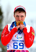 Gold medalist Aleksandr Pronkov of Russia poses during the medal ceremony for the Men's Cross Country 10km Free – Standing on day nine of the Sochi...