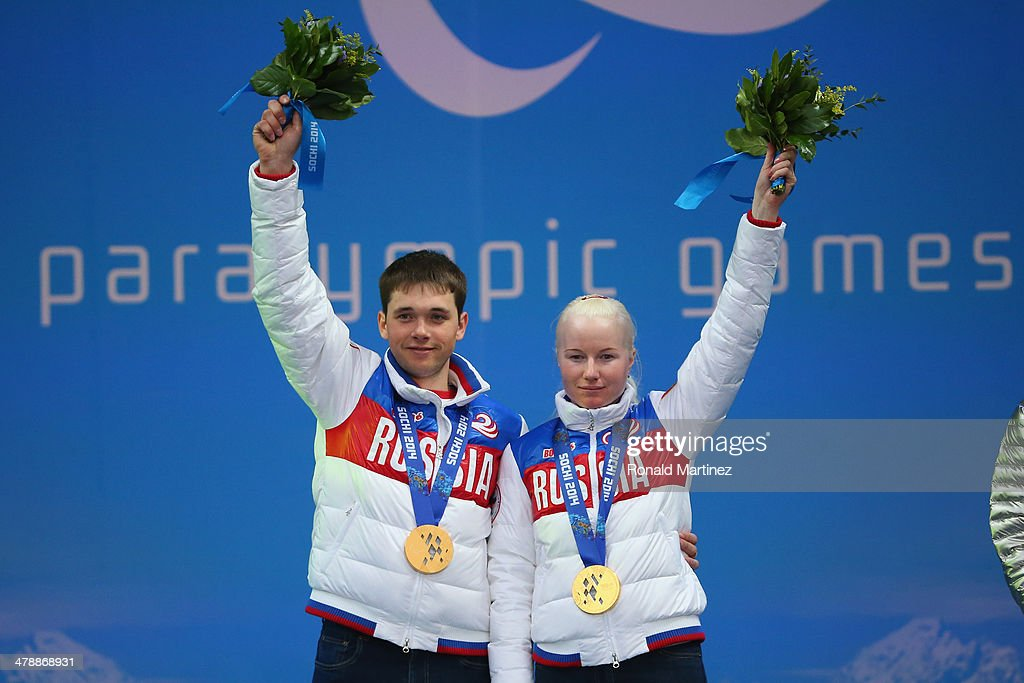 Gold medalist Aleksandra Frantceva of Russia and guide Pavel Zabotin celebrate at the medal ceremony for women's Super Combined Visually Impaired on day eight of the Sochi 2014 Paralympic Winter Games at Laura Cross-country Ski & Biathlon Center on March 15, 2014 in Sochi, Russia.