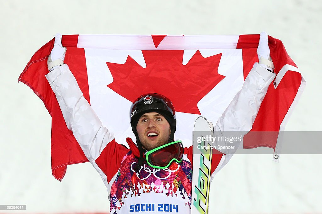 Gold medalist Alex Bilodeau of Canada celebrates during the flower ceremony for the Men's Moguls Finals on day three of the Sochi 2014 Winter...