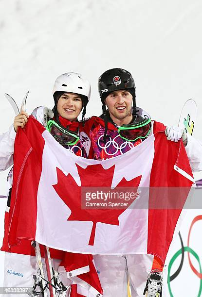 Gold medalist Alex Bilodeau of Canada celebrates with silver medalist Mikael Kingsbury of Canada after the Men's Moguls Finals on day three of the...