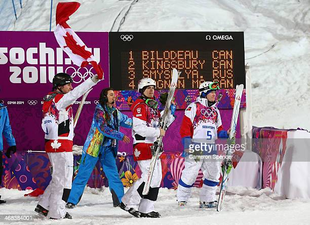 Gold medalist Alex Bilodeau of Canada silver medalist Mikael Kingsbury of Canada and Alexandr Smyshlyaev of Russia celebrate before the flower...