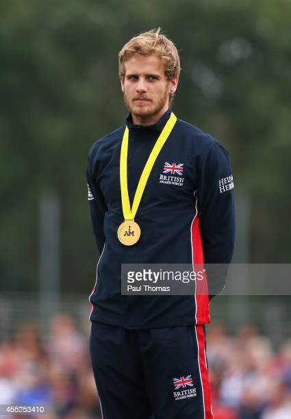 Gold medalist Alex Tate of Great Britain poses during the medal ceremony for the 100m Men Ambulant IT1 final during day 1 of the Invictus Games...