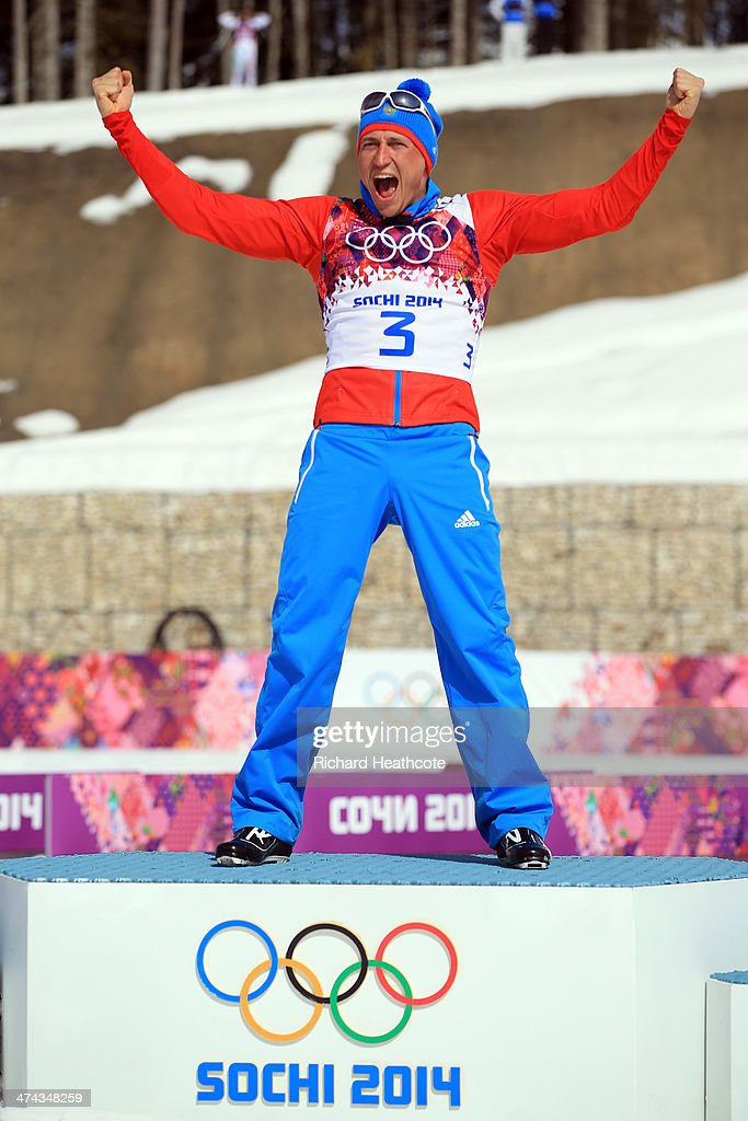 Gold medalist Alexander Legkov of Russia celebrates during the flower ceremony for the Men's 50 km Mass Start Free during day 16 of the Sochi 2014 Winter Olympics at Laura Cross-country Ski & Biathlon Center on February 23, 2014 in Sochi, Russia.