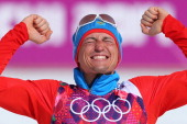 Gold medalist Alexander Legkov of Russia celebrates during the flower ceremony for the Men's 50 km Mass Start Free during day 16 of the Sochi 2014...