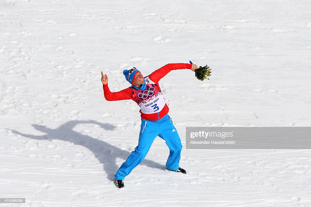 Gold medalist <a gi-track='captionPersonalityLinkClicked' href=/galleries/search?phrase=Alexander+Legkov&family=editorial&specificpeople=4037875 ng-click='$event.stopPropagation()'>Alexander Legkov</a> of Russia celebrates during the flower ceremony for the Men's 50 km Mass Start Free during day 16 of the Sochi 2014 Winter Olympics at Laura Cross-country Ski & Biathlon Center on February 23, 2014 in Sochi, Russia.