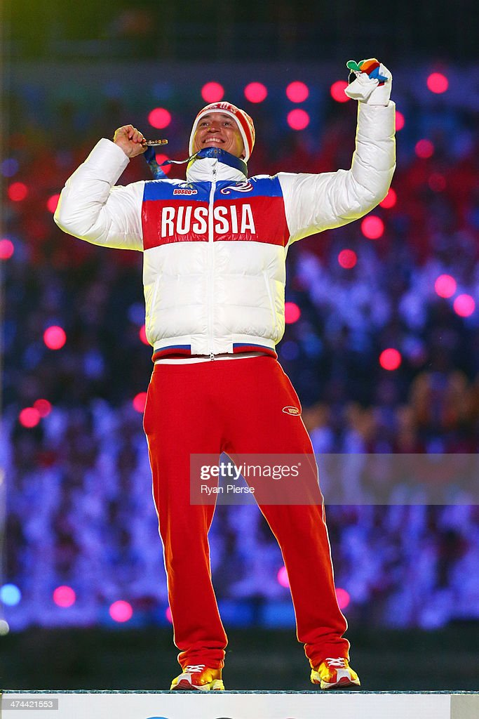 Gold medalist <a gi-track='captionPersonalityLinkClicked' href=/galleries/search?phrase=Alexander+Legkov&family=editorial&specificpeople=4037875 ng-click='$event.stopPropagation()'>Alexander Legkov</a> of Russia celebrates in the medal ceremony for the Men's 50 km Mass Start Free during the 2014 Sochi Winter Olympics Closing Ceremony at Fisht Olympic Stadium on February 23, 2014 in Sochi, Russia.