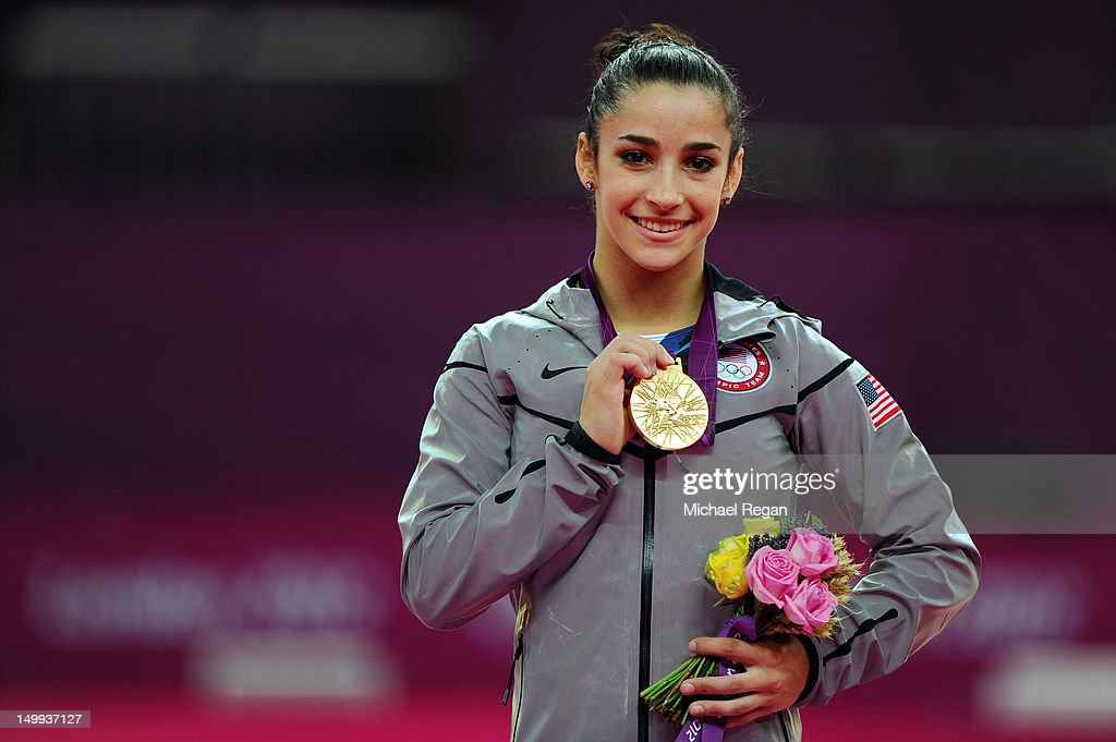 Gold medalist <a gi-track='captionPersonalityLinkClicked' href=/galleries/search?phrase=Alexandra+Raisman&family=editorial&specificpeople=7138858 ng-click='$event.stopPropagation()'>Alexandra Raisman</a> of the United States poses on the podium during the medal ceremony for the Artistic Gymnastics Women's Floor Exercise final on Day 11 of the London 2012 Olympic Games at North Greenwich Arena on August 7, 2012 in London, England.
