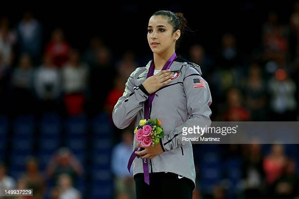 Gold medalist Alexandra Raisman of the United States poses on the podium during the medal ceremony for the Artistic Gymnastics Women's Floor Exercise...