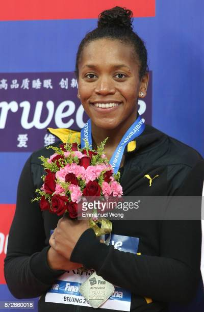 Gold medalist Alia Atkinson of Jamaica poses during the medal ceremony for the Women's 200m Breastroke final on day two of the FINA swimming world...