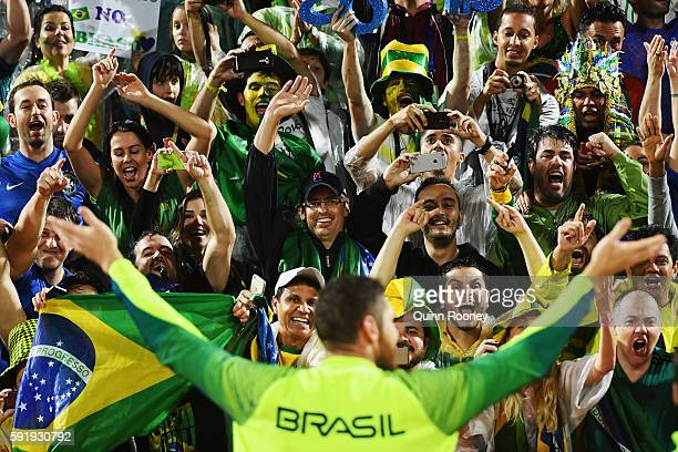 Gold medalist Alison Cerutti of Brazil celebrates following the medal ceremony for the Men's Beachvolleyball contest at the Beach Volleyball Arena on...