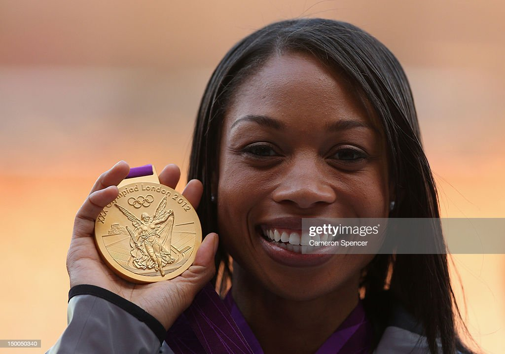 Gold medalist <a gi-track='captionPersonalityLinkClicked' href=/galleries/search?phrase=Allyson+Felix&family=editorial&specificpeople=213459 ng-click='$event.stopPropagation()'>Allyson Felix</a> of the United States poses on the podium during the medal ceremony for the Women's 200m on Day 13 of the London 2012 Olympic Games at Olympic Stadium on August 9, 2012 in London, England.