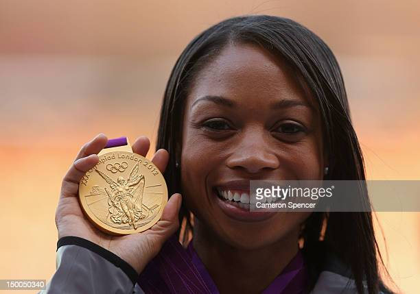 Gold medalist Allyson Felix of the United States poses on the podium during the medal ceremony for the Women's 200m on Day 13 of the London 2012...