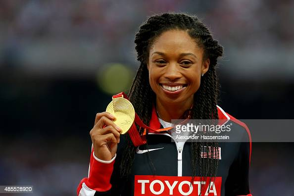 Gold medalist Allyson Felix of the United States poses on the podium during the medal ceremony for the Women's 400 metres final during day seven of...