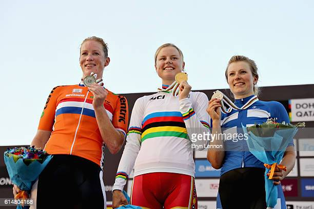 Gold medalist Amalie Dideriksen of Denmark celebrates on the podium with second placed Kirsten Wild of Netherlands and third placed Lotta Lepisto of...