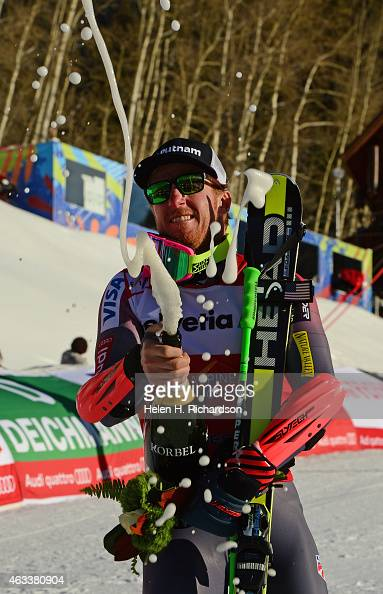 Gold medalist American Ted Ligety celebrates with the Men's Giant Slalom by spraying champagne in the air after the flower ceremony at the FIS Alpine...