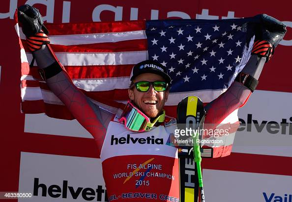 Gold medalist American Ted Ligety raises an American flag in the air and smiles to the crowd after winning the Men's Giant Slalom at the FIS Alpine...