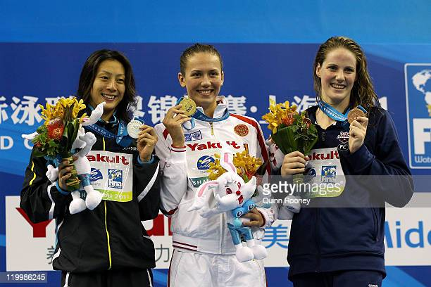 Gold medalist Anastasia Zueva of the Russia Federation poses with silver medalist Aya Terakawa of Japan and bronze medalist Melissa Franklin of the...