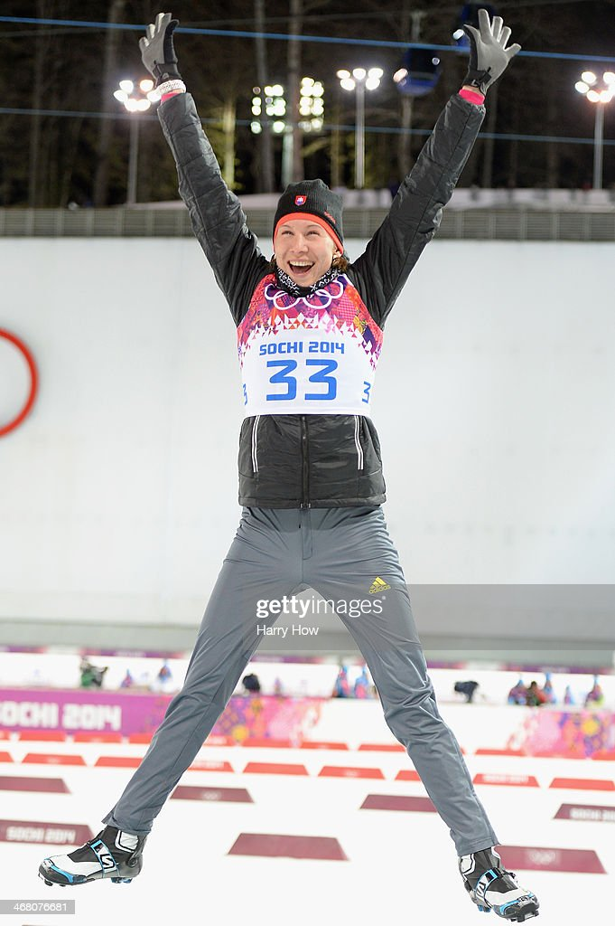 Gold medalist <a gi-track='captionPersonalityLinkClicked' href=/galleries/search?phrase=Anastasiya+Kuzmina&family=editorial&specificpeople=6738529 ng-click='$event.stopPropagation()'>Anastasiya Kuzmina</a> of Slovakia celebrates during the flower ceremony after the Women's 7.5 km Sprint during day two of the Sochi 2014 Winter Olympics at Laura Cross-country Ski & Biathlon Center on February 9, 2014 in Sochi, Russia.