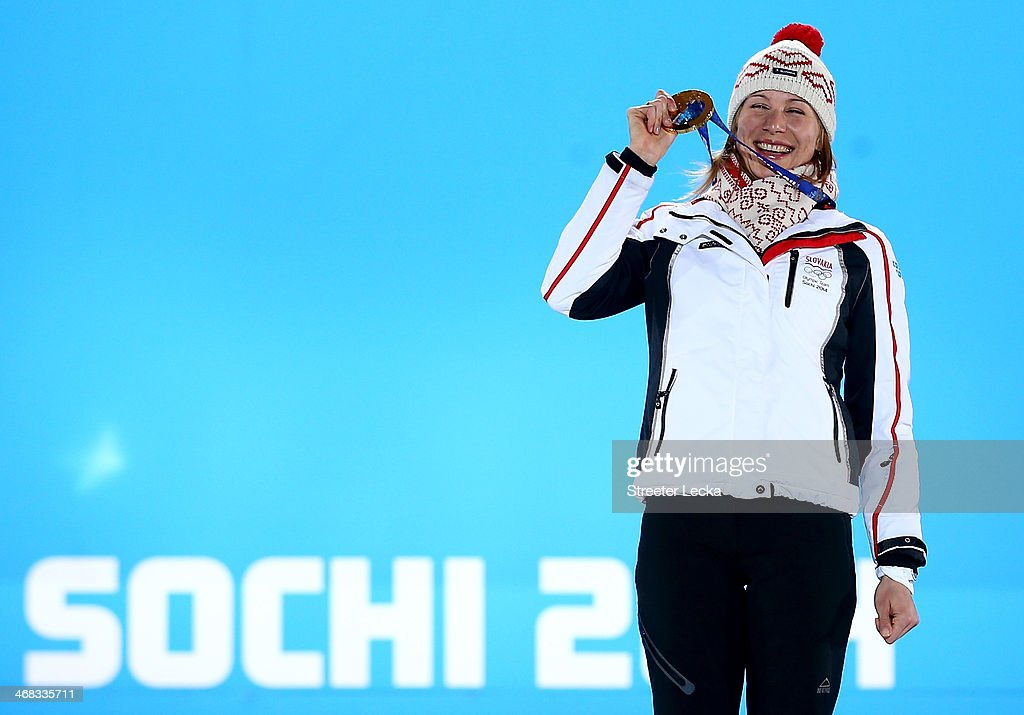 Gold medalist <a gi-track='captionPersonalityLinkClicked' href=/galleries/search?phrase=Anastasiya+Kuzmina&family=editorial&specificpeople=6738529 ng-click='$event.stopPropagation()'>Anastasiya Kuzmina</a> of Slovakia celebrates during the medal ceremony for the Biathlon Women's 7.5 km Sprint on day 3 of the Sochi 2014 Winter Olympics at Medals Plaza in the Olympic Park on February 10, 2014 in Sochi, Russia.