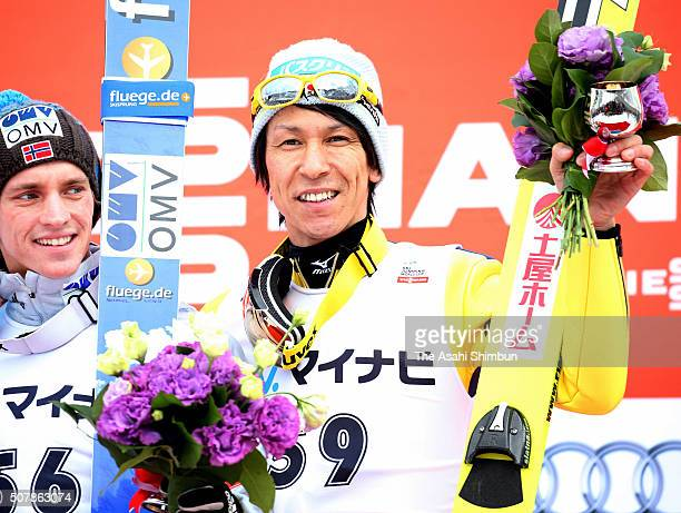 Gold medalist Anders Fannemel of Norway and bronze medalist Noriaki Kasai of Japan pose on the podium during day two of the FIS Ski Jumping World Cup...