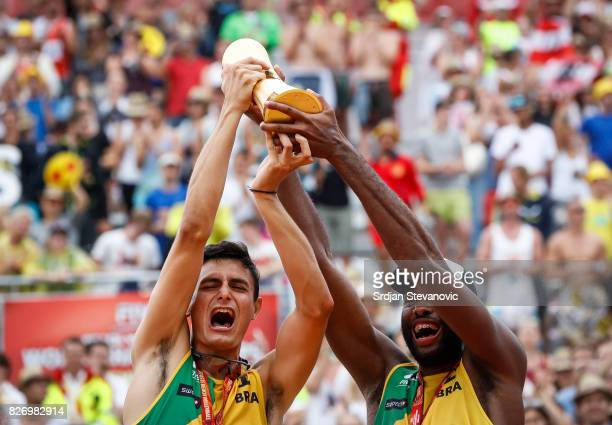 Gold medalist Andre Loyola and Evandro lift their winners trophy during the medal ceremony for the Men's Final on August 06 2017 in Vienna Austria