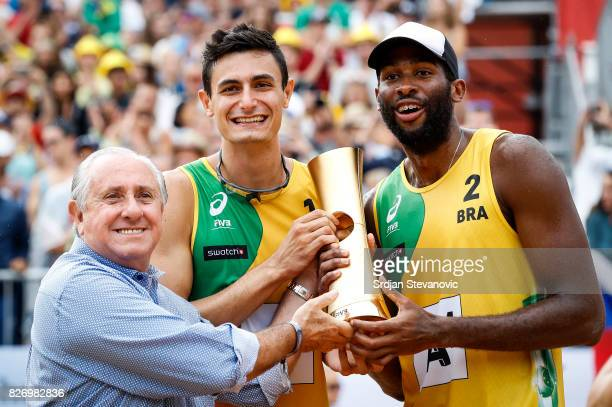 Gold medalist Andre Loyola and Evandro receive their winners trophy from the Dr Ary S Graa F¡ President of FIVB during the medal ceremony for the...