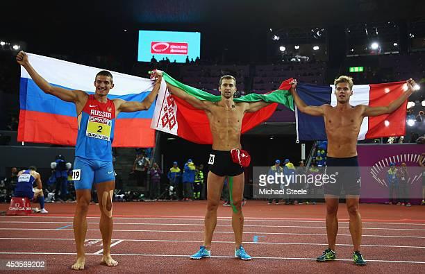 Gold medalist Andrei Krauchanka of Belarus silver medalist Kevin Mayer of France and bronze medalist Ilya Shkurenyov of Russia celebrate after the...