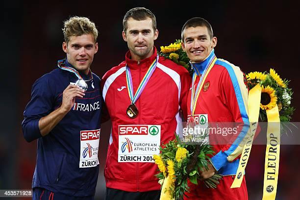 Gold medalist Andrei Krauchanka of Belarus silver medalist Kevin Mayer of France and bronze medalist Ilya Shkurenyov of Russia celebrate on the...