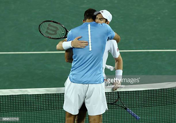 Gold medalist Andy Murray of Great Britain hugs silver medalist Juan Martin Del Potro of Argentina after the Men's Singles Finals on Day 9 of the Rio...