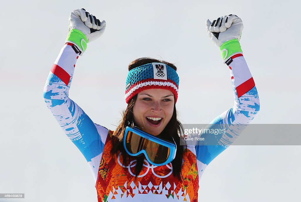 Gold medalist <a gi-track='captionPersonalityLinkClicked' href=/galleries/search?phrase=Anna+Fenninger&family=editorial&specificpeople=4045781 ng-click='$event.stopPropagation()'>Anna Fenninger</a> of Austria celebrates during the flower ceremony for the Alpine Skiing Women's Super-G on day 8 of the Sochi 2014 Winter Olympics at Rosa Khutor Alpine Center on February 15, 2014 in Sochi, Russia.