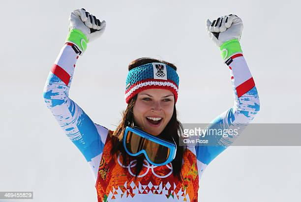 Gold medalist Anna Fenninger of Austria celebrates during the flower ceremony for the Alpine Skiing Women's SuperG on day 8 of the Sochi 2014 Winter...