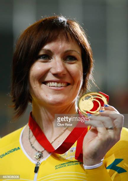 Gold medalist Anna Meares of Australia celebrates on the podium after winning in the Women's 500m Time Trial at Sir Chris Hoy Velodrome during day...