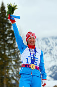 Gold medalist Anna Milenina of Russia poses during the medal ceremony for the Women's Cross Country 5km Free – Standing on day nine of the Sochi 2014...
