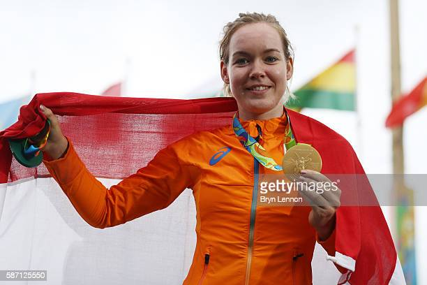 Gold medalist Anna van der Breggen of the Netherlands celebrates after winning the Women's Road Race on Day 2 of the Rio 2016 Olympic Games at Fort...