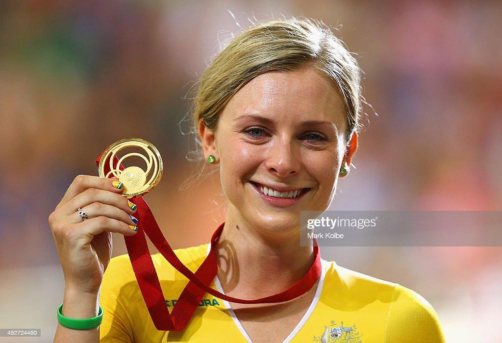 Gold medalist <a gi-track='captionPersonalityLinkClicked' href=/galleries/search?phrase=Annette+Edmondson&family=editorial&specificpeople=4872666 ng-click='$event.stopPropagation()'>Annette Edmondson</a> of Australia celebrates on the podium during the medal ceremony for the Women's 10km Scratch finals at Sir Chris Hoy Velodrome during day three of the Glasgow 2014 Commonwealth Games on July 26, 2014 in Glasgow, United Kingdom.