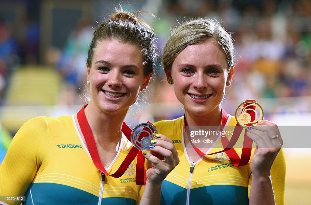 Gold medalist <a gi-track='captionPersonalityLinkClicked' href=/galleries/search?phrase=Annette+Edmondson&family=editorial&specificpeople=4872666 ng-click='$event.stopPropagation()'>Annette Edmondson</a> of Australia celebrates on the podium alongside silver medalist <a gi-track='captionPersonalityLinkClicked' href=/galleries/search?phrase=Amy+Cure+-+Cyclist&family=editorial&specificpeople=5663459 ng-click='$event.stopPropagation()'>Amy Cure</a> of Australia (L) during the medal ceremony for the Women's 10km Scratch finals at Sir Chris Hoy Velodrome during day three of the Glasgow 2014 Commonwealth Games on July 26, 2014 in Glasgow, United Kingdom.