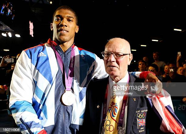Gold medalist Anthony Joshua of Great Britain celebrates with retired lightweight boxter Richard McTaggart MBE after the medal ceremony for the Men's...
