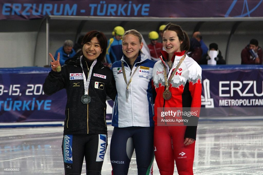 Gold medalist <a gi-track='captionPersonalityLinkClicked' href=/galleries/search?phrase=Arianna+Fontana&family=editorial&specificpeople=4680451 ng-click='$event.stopPropagation()'>Arianna Fontana</a> of Italy (C), Silver medalist <a gi-track='captionPersonalityLinkClicked' href=/galleries/search?phrase=Yui+Sakai&family=editorial&specificpeople=6521438 ng-click='$event.stopPropagation()'>Yui Sakai</a> of Japan (L) and Bronze medalist Kim Boutin of Canada (R) pose for a picture after winning the Women's 1000m final of the ISU World Cup Short Track Speed Skating on February 15, 2015 in Erzurum, Turkey.