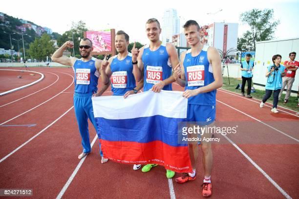 Gold medalist Artur Abdrakhmanov Konstanti Grebenshchikov Victor Oblomkov ile Anton Sharapo of Russia hold a Russian flag after the Men's 4x400...