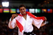 Gold medalist Ashley McKenzie of England poses during the medal ceremony for the Men's 60kg Gold medal contest at SECC Precinct during day one of the...