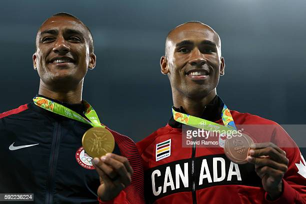 Gold medalist Ashton Eaton of the United States and bronze medalist Damian Warner of Canada pose on the podium during the medal ceremony for the...