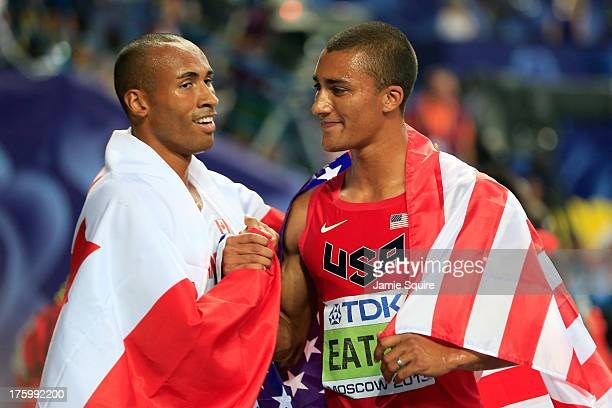 Gold medalist Ashton Eaton of United States is congratulated after the Men's Decathlon 1500 metres by bronze medalist Damian Warner of Canada during...