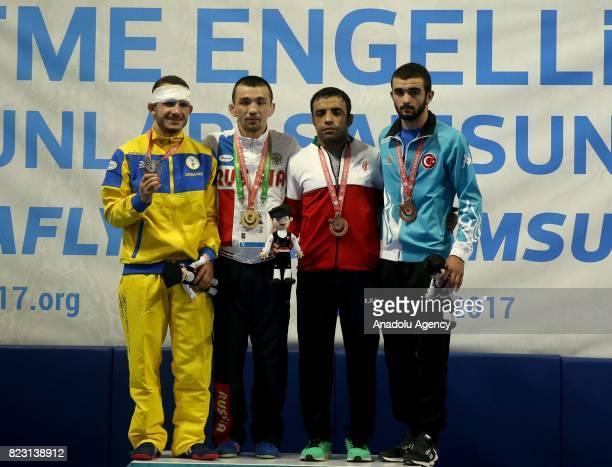 Gold Medalist Askar Askarov of Russia silver medalist Andrii Kambur of Ukraine bronze medalist Mehdi Bakhsh of Iran and bronze medalist Mehmet Ali...