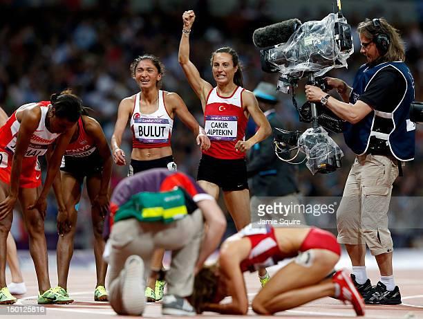 Gold medalist Asli Cakir Alptekin of Turkey celebrates with silver medalist Gamze Bulut of Turkey as Morgan Uceny of the United States receives...