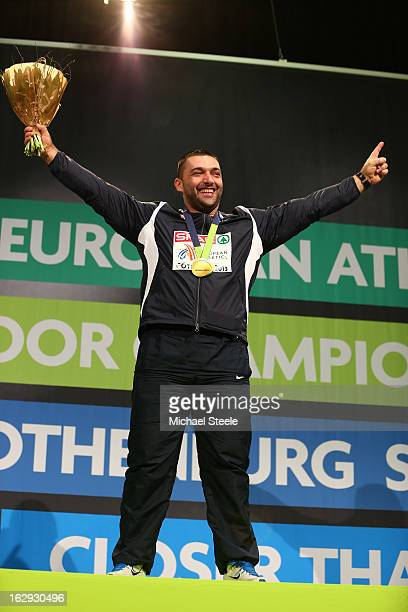 Gold medalist Asmir Kolasinac of Serbia poses during the victory ceremony for the Men's Shot Put during day one of the European Athletics Indoor...