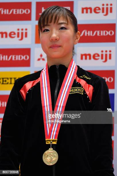 Gold medalist Asuka Teramoto looks on in the award for the balance beam ceremony during Japan National Gymnastics Apparatus Championships at the...