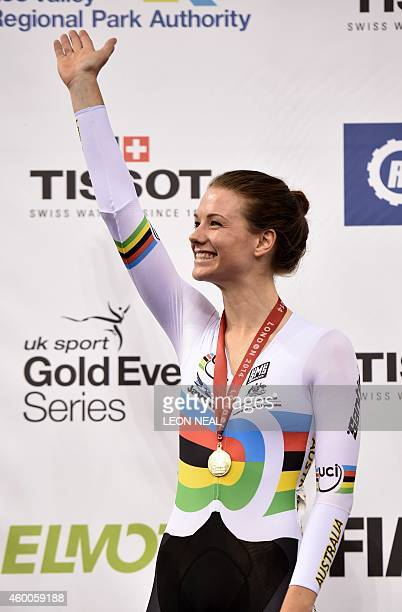 Gold medalist Australia's Amy Cure celebrates on the podium following the Women's Points Race Final at the UCI Track Cycling World Cup at the Lee...